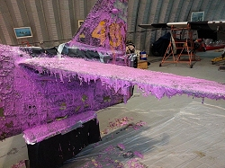 Paint stripper gives the Curtiss P-40 a strange scheme.