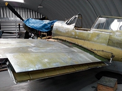 All the paint removed reveals the superb condition of the Curtiss P-40.