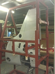 The fin and rear fuselage in a jig.